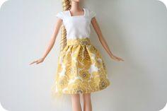 http://www.craftinessisnotoptional.com/2010/09/froufy-barbie-skirt-tutorial.html
