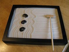 Project 33. Picture frame + sand + stone = miniature zen garden • DIY project by DIY Maven, via Curbly