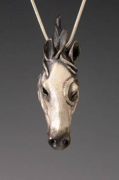 Handcrafted Silver Totem Horse Pendant http://www.brookestonejewelry.com/store/photos/106/index.htm