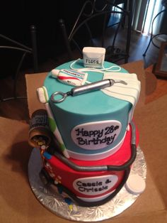 the cutest cake ever! half hygiene and half nurse theme for twin professions!