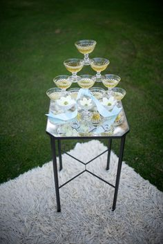 Set up champagne glasses in a tower for guests to admire before they grab one! #greatgatsby #gatsbyinspired #gatsbywedding