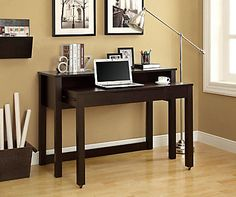 "Two is better than one so why not get this space saver nesting desk. Use the top table to display pictures and decorative items while the retractable desk on castors can be pulled out, for your convenience, when you need to use you laptop. Finished in a rich cappuccino, this 48""long desk can be placed in the hallway, home office or even your bedroom!"