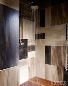 Fashion Editor Kim Hersov's Shower Room: The shower room is sheathed in horn tiles, and the floor is teak.