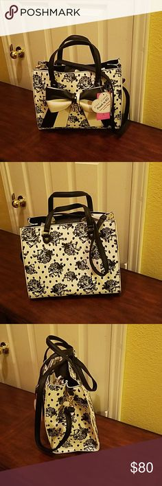 Betsey Johnson Satchel NWT Bag in a bag with nice floral prints. Snap closure on top, one interior zipper. Long removable and adjustable strap.  Colors are off white, gray and black. Betsey Johnson Bags Satchels