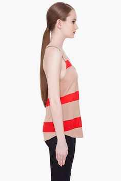 HAUTE HIPPIE //  SILK TRIM RACERBACK TANK TOP  21235F115002    Scoopneck tank top in nude. Red silk stripes throughout. Tone on tone stitching. 100% modal. Contrast: 100% silk. Dry clean. Made in United States.  $175.00 USD  $88.00 USD You Save 50%  This item is on final sale     SIZE GUIDE  ADD TO BAG