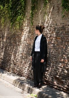 CÉLINE Black Long and Straight Cashmere and Wool Coat http://departementfeminin.com/en/designers/celine/