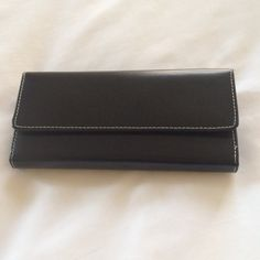 Jack Georges wallet Gently used, gorgeous Jack Georges black leather wallet, colorful interior, minor fading on the inside. Jack Georges Bags Wallets