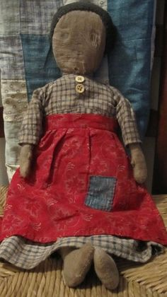 """This gal is really special!  She has a repaired head and early wool hair.  Her dress is a wonderful, bumpy homespun and her apron is the sweetest, red calico.  She is stitched entirely by hand and stuffed with old rags.  She's nice and heavy and feels good and old!  She is 19 ½"""" tall.  She is a signed and dated Fat Hen Farm original"""