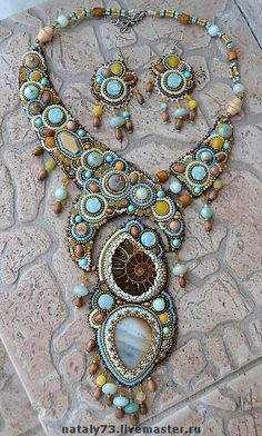 Handmade. Love this...the colors, the ammonite, everything works well together.
