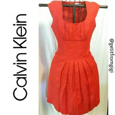 Calvin Klein Pleated Dress Perfect for the office. Short sleeves. Pleated. Lightweight material. Size 2. Color is red. Calvin Klein Dresses Midi