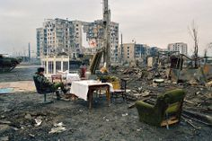 Russian soldiers relaxing in the ruins of Grozny. February 4, 2000. [990x659] - Imgur
