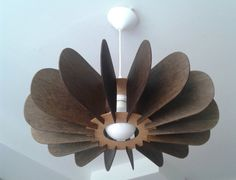 Pendant lamp made of 3mm bent plywood stained brown
