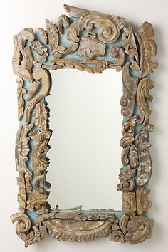 Handcarved wooden curves, leaves and flourishes are reproduced from a French antique, and then pieced together in decorative disarray atop a sizeable plaster-inspired frame