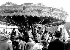 Long Lines Waiting To Take A Turn On The Galloping Belgium Carousel At The New York World's Fair 1964-65