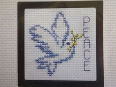 This beautiful peace dove counted cross stitch kit shows the dove with a sprig next to the word peace. Beautiful for this time of year! The kit includes a frame, aida cloth, floss, needle, and chart. The finished size is Thank You! Cross Stitch Alphabet, Cross Stitch Samplers, Cross Stitching, Cross Stitch Patterns, Peace Dove, Christmas Cross, Plastic Canvas Patterns, Stitch Kit, Needlework