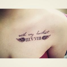 Gorgeous Roman Numerals With Angel Wings And Lettering Tattoo On Chest
