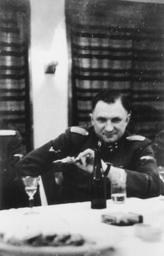 Close-up portrait of SS officer Richard Baer, Commandant of Auschwitz, at the table of a hunting lodge.