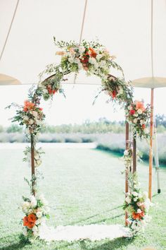 Beautiful and Romantic Garden in Orange & White for a Wedding Arbor Idea..love how it's covered by a tent for the sun. . Great idea !