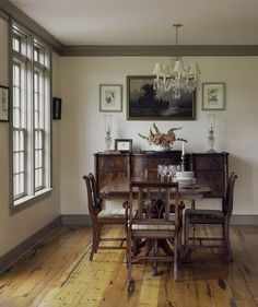 Dining room in a LEED certified farmhouse by Connor Homes, with reclaimed light fixtures and wide board pine floors