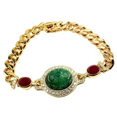 Van Cleef & Arpels Carved Emerald Ruby Diamond Gold Bracelet | From a unique collection of vintage link bracelets at https://www.1stdibs.com/jewelry/bracelets/link-bracelets/