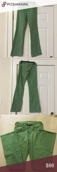 Rare Green 7 for all Mankind Jeans Green 7 for all Mankind extemely rare bootcut jeans Size 26. Small tear at the bottom of the zipper which could cause it to come off track. Still works just fine now and one stitch would fix it! 7 For All Mankind Jeans Boot Cut