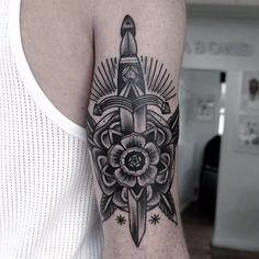 Dagger and Tudor rose tattoo with exquisite shading by Paul Hill, photo from portfolio on iamvagabond.co.uk #PaulHill #VagabondStudio #traditional #blackworkers #dagger #tudorrose
