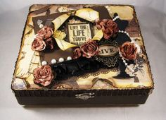 I love this altered cigar box!