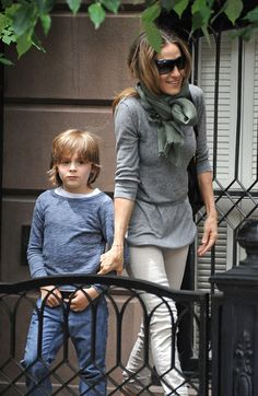 """James Wilkie Broderick waits for his mom Sarah Jessica Parker before they leave their NYC home together. The """"I Don't Know How She Does It"""" star was wearing rolled up khakis, a grey sweater and scarf wrapped around her neck."""