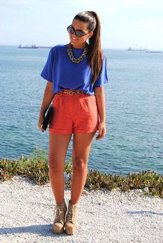A great example of how you can pull off a flowy top...tuck it in some to define your waist. Great color inspiration