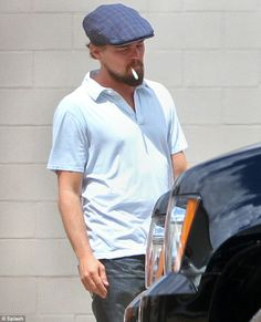Leonardo DiCaprio puffs away on an #ecigarette between takes of Django Unchained