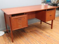 Danish Teak Desk with Rear Storage    Denmark, 1960s. A very functional and well designed desk with plenty of good storage, including a deep, rear book shelf. Nice patina on the teak wood surfaces. Great condition.