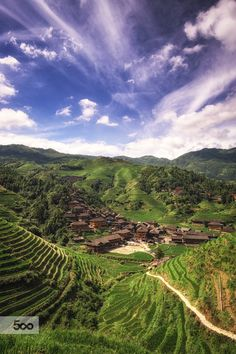 The Dragon Village by Aaron Choi on 500px - Dazhai, Guangxi, China -  A small village located in the heart of longji rice terrace in guangxi region of China. It is amazing to see small villages tucked well into the valleys filled with rice terraces. It must have taken the villagers generations to fully turn these mountains and hilltops into farms, and even creating a irrigation system to pump the water up to the top of the mountain. The village reminded me of what humans could accomplish