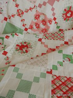 Christmas version of the Pot Luck quilt with delightful Christmas Dresden Plate blocks.