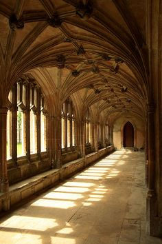 Cloisters at Lacock Abbey, Wiltshire, England. Look at those shadows and the light coming through the windows