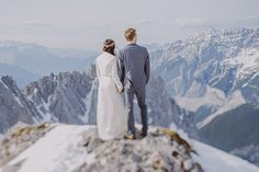 Love the mountain background...this #wedding photo is gorgeous! From http://100layercake.com/blog/2014/12/02/snowy-alpine-wedding-portraits-winter-mountain-wedding/  Photo Credit: http://www.faistenberger.com/en/