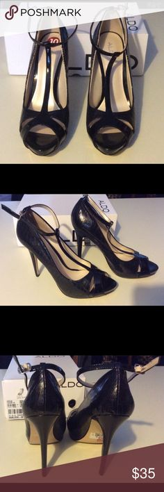 """ALDO Vanliere Heels - Fits a """"9"""" Beautiful ALDO Vanliere Heels w/box.  Open Toe, t-strap w/adjustable ankle strap.  4"""" a 5"""" raised Heels w/approx 3/4"""" platform.  Size 40 in ALDO world fits a US size 9.  See their website for more details.  Bottoms show some store wear, but the shoes are new, mine and I never wore them.  The insides are clean and obviously unworn. ALDO Shoes Heels"""