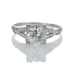 Intricate band has a lot of character. The split band doesn't look as delicate though. Leigh Jay Nacht Inc. - Engagement Rings.  Don't like split shank of band, but do like the setting of the ring. The diamond is round, but looks square because of the corners on the setting.