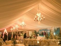 love chandeliers in an outdoor wedding or event...they make it look so elegant yet the nature keeps things so simple.