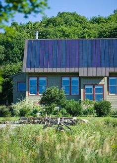 Integrated solar roof. The south face of this standing-seam metal roof is overlaid with a four kilowatt array of thin film solar panels. truexcullins.com