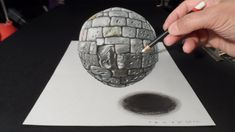 Drawing a realistic stone sphere. 3 dimension stone ball. Trick art on paper. Stone texture. Magic realism. Anamorphic Illusion. Anamorphosis. Trick art the ...