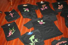 Kids stencil black shirts with neon paint for glow-in-the-dark party