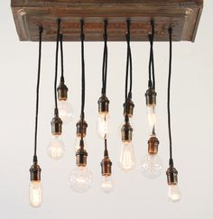Copper Salvaged barn tin chandy with varying edison-style bulbs. $275.00, via Etsy.