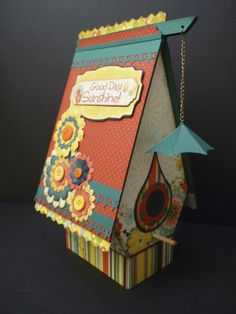 This is a bird house I made using on of Laura Denison's Bird Abode projects. The roof lifts up to revel a hidden mini album. If you haven't seen Laura Denison's work yet check her out.
