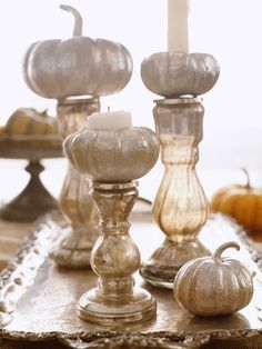 An elegant centerpiece is as simple as gathering a few mini pumpkins on a tray. Place them on candle holders in place of candles, or carve out the center of the pumpkin and place the candle inside. Try spray painting the pumpkins first to pull the whole display together.