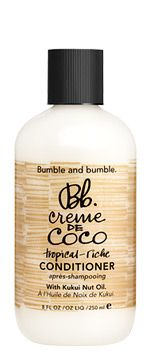 Bumble and bumble creme de coco shampoo or conditioner $8.  I cheat on this here & there, but it is a regular staple for me.  It smells delightful & works well.  I'm a natural blonde & have never had trouble with brassiness from this either.