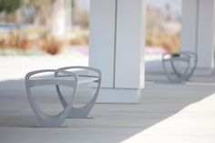 Trio Benches shown in 6 foot, backless configuration with Silver Texture powdercoated frame and clear anodized aluminum slats at San Bernadino International Airport, San Bernardino, California