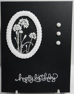 black handmade card with white  sentiment, embossed flowers, brads and die cut frame ...