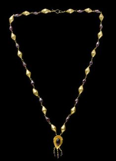 A Roman gold and garnet bead necklace Circa 3rd Century A.D. and later