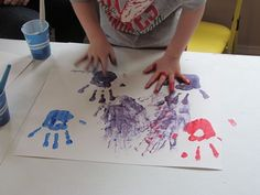 Adorable idea for teaching color mixing. Paint one hand red, one hand blue, and make a set of prints. Then rub your hands together and make another set of (purple!) prints. Fun!