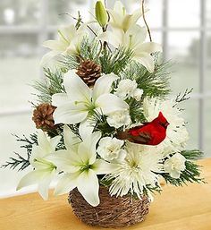 Invite the serenity and beauty of winter into your home with this hand-crafted Wintertime Birds Nest of Flowers.